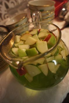 Appletinis..InStyle Magazine's Party book...5c vodka, 5c apple Schnapps, 7c apple juice. I add red and green apple slices or chunks for Christmas.