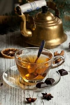 Picture of Hot winter tea with dark chocolate and old vintage teapot on old wooden table stock photo, images and stock photography. Coffee Time, Tea Time, Coffee Break, Momento Cafe, Café Chocolate, Thé Oolong, Cuppa Tea, Tea Art, Christmas Tea