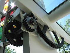 Gears for pivoting wall door