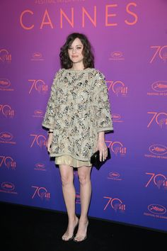 Marion Cotillard wore an embroidered beige linen dress and a beige linen skirt from Chanel and Alexander Wang heels.