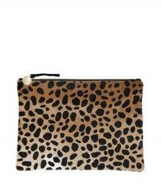 Best Handbags and Purses :    Picture    Description  Clare Vivier Leopard Pony Hair Clutch – More ways to wear a crop top: www.harpersbazaar…