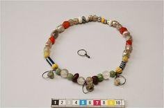 """Necklace with bead pendants from Birka grave, Sweden. Date: 800-1100.  """"41 pärlor och 3 pärlhängen (av silvertråd). 4 av karneol, 3 av bergkristall, 2 av bärnsten övriga av glas ( av vilka 13 är silverfolierade)."""""""