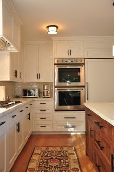 When we install our cabinet buffet area. I want to do wood cabinets. Though the rest of the kitchen is a cream color. This two tone cabinets seems to be a trend.