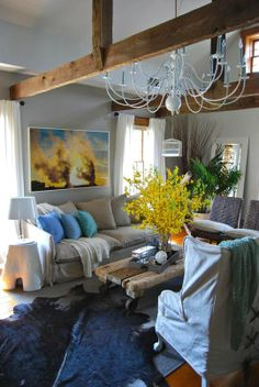 So many things to love about this room, the colour pop of yellow, the comfy sofa, the beam, the plants, the rug, the light..