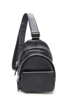 A faux leather sling mini backpack featuring two zippered compartments, one front flap pocket with snap-magnetic closure, one interior zipper pocket, and an adjustable shoulder strap.