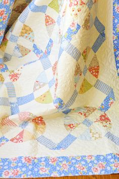 sunwashed.  a simple 1 block quilt that is created primarily through the pieced sashing
