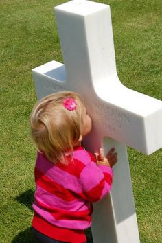 This picture was taken at the American cemetry in Normandy France. My daughter walked up, on her own, to about 10+ different crosses and started kissing them. Brought me to tears....Sweetest thing I've ever witnessed.