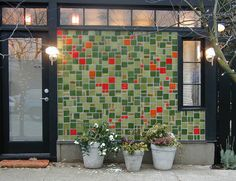 Blazestone 100% recycled glass tile used on a facade.  www.bedrockindustries.com