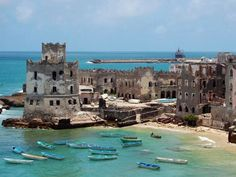 A haunting ruin - The lighthouse on the edge of Mogadishu's Old Harbor was built more than a century ago but is now an abandoned, bullet-pocked shell that is a home to only homeless fishermen and qat-junkies.