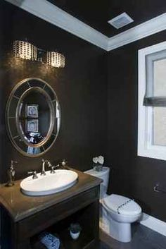 A coat of rich brown paint on the walls and a crystal light fixture dress up this powder room and make it sparkle like a jewel. The powder room is one of the busiest rooms in the house during the holidays, so take the opportunity now to give yours a quick makeover