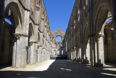 The Abbey of Saint Galgano was a Cistercian Monastery found in the valley of the river Merse between the towns of Chiusdino and Monticiano, in the province of Siena, region of Tuscany, Italy. Presently, the roofless walls of the Gothic style 13th-century Abbey church still stand.
