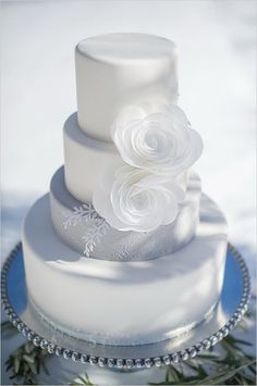 White and grey wedding cake by Intricate Icings Cake Design featuring wafer paper flowers.