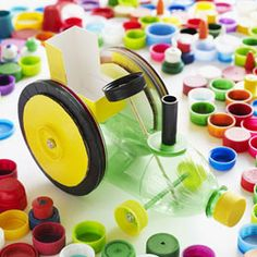 """tractor = 8 (3-3/4"""" diameter) cardboard disks + yellow duct tape + black tape + 6 CDs + pushpin + 3 wooden skewers (cut into two 5"""" pieces and one 3-3/4"""" piece) + glue dots + fabric measuring tape + plastic 20-oz. plastic bottle + straw (cut into two 3"""" pieces) + 3 milk-jug caps + 5 small 7/16"""" hex nuts + 3 yellow soda-bottle caps + empty soap box + large black bottle cap + black marker cap"""