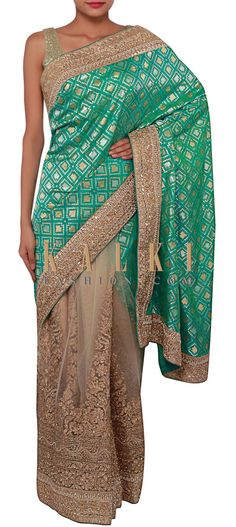 Buy Online from the link below. We ship worldwide (Free Shipping over US$100) http://www.kalkifashion.com/green-and-cream-half-and-half-saree-adorn-in-zari-embroidery-only-on-kalki.html