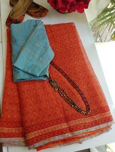 For the love of block print in orange with grey edging Cotton Saree Designs, Saree Blouse Neck Designs, Saree Blouse Patterns, Trendy Sarees, Stylish Sarees, Fancy Sarees, Silk Saree Kanchipuram, Bandhani Saree, Saree Trends