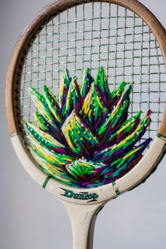 Danielle Clough – embroidered plant on vintage tennis racket