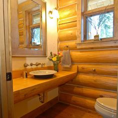 a guest bath - love the wood slab counter