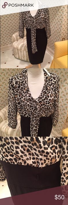 White House Black Market Leopard Dress NWT. High waisted, very flattering. Leopard print silk blouse and black skirt sewn together as a dress with side zip. Top features tie that you can do as a bow or leave loose. Features belt loops for a skinny belt (see photos), NO BELT INCLUDED. Very flattering! White House Black Market Dresses