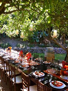 love love this table & the candles in the trees