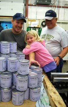 A family affair: volunteers and MCC's meat canning program - Mark Schroeder (left), his daughter Brin and his father Arlyss, seen here in 2009, regularly help with MCC's meat canning when it comes to North Newton, Kan.  (Photo/Shel Schroeder)