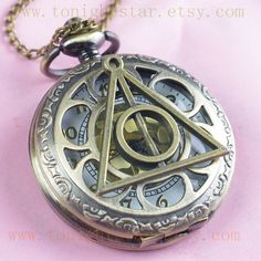 Harry Potter Deathly Hollows Pocket Watch necklace,Golden Dial Pocket Watch necklace. $6.99, via Etsy.