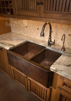 Hammered copper farmhouse sink.