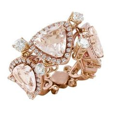 Ring set in pink gold, diamonds and three morganite stones