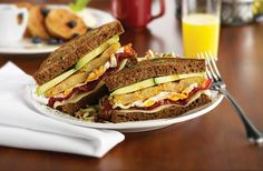 Best Breakfast Sandwich 2015 - Fried green tomato, applewood-smoked bacon, avocado mash, cheddar cheese, fried egg and pumpernickel bread