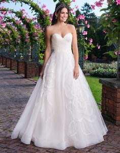 Sincerity wedding dress style 3910 A sweetheart tulle ball gown with laser cut crinkle organza, hand placed floral details, and a chapel length train perfect for the romantic bride.