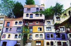 """Hundertwasser- Hundertwasser Haus, Vienna, 1983-86. hundertwasser.at Note the tree growing out of window. He published a manifesto; 'Your window right – your tree duty' """"A journey into the land of creative architecture where there are window rights and tree tenants and uncontrolled irregularities; uneven floors, woodlands on the roof, spontaneous vegetation and barriers of beauty..."""""""