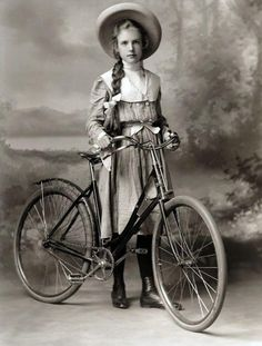 "onceuponatown: "" Girl with bike. Late 1800s/early 1900s. """
