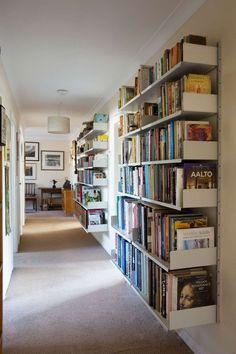 A narrow hallway easily accommodates a large library vitsoe Hallway Closet, Hallway Storage, Hallway Shelf, Apartment Entryway, Entryway Decor, Entryway Ideas, Hallway Ideas, Apartment Bookshelves, Grand Entryway