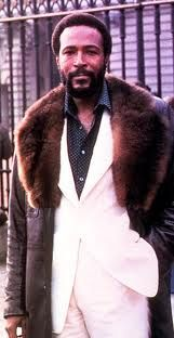 Marvin Gaye in fur coat with white suit underneath