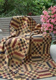 Picnic Quilt Primitive Gatherings Quilt Shop. A 5-strip block & a 25-patch block alternately pieced together.