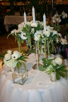 A vision in all white with silver accents. Gorgeous silver candleabra and julep cups overflowing with roses, peonies, gerber daisies, stephanotis and hanging amananthus.