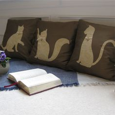 Whether you are a cat lover or just want a feline touch to your décor, the Siamese is a purrfect addition to any room.  The three piece handmade decorative pillow cover set features three playful friends.  I've named them Mittens, Whiskers and Paul but you can choose your own names.  The silhouettes feature a patterned silk with a ribbon and charm collar.