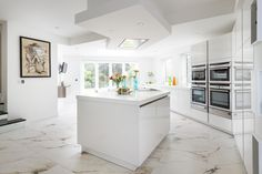 Alternative view of this kitchen which cleverly incorporates a diagonal theme Corian Worktops, Cooking For A Crowd, Centre Pieces, Architect Design, Kitchen Ideas, House, Slg, Alternative, Home Decor