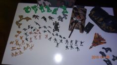 Lot-of-toy-army-soldiers-with-two-tanks-a-jet-and-other-items