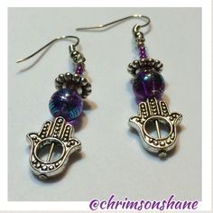 🆕 Pretty Purple Hamsa Earrings Pretty Hamsa earrings features blue-streaked purple glass beads and iridescent purple seed beads. Hamsa charm is silver tone.All of my handcrafted earrings are one-of-a-kind. Have a nickel allergy? Let me know and I'll be glad to change out the hooks on any of my handcrafted earrings so they are wearable for your sensitive ears. 💗 🌟Top-Rated Seller 📦Fast Shipper 🌟Top 10% Seller 💲Discount on Bundles 💖Free Gift For All Orders $20 & up 🚫No Paypal 🚫No…