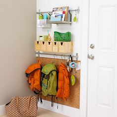 DIY : Love This! Create a Handy Storage System by Your Back Door. Using a towel bar with hooks for backpacks is so smart! And I love the cork board under neath .... Great for making sure the wall doesn't get scratched or you can use it for displaying art work from school, or permission slips for those field trips they want to go on!