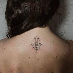 Hand poked Hamsa tattoo on the upper back. Tattoo Artist: Ann...