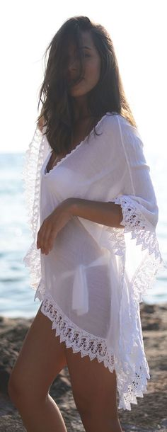 Pretty white coverup with cute lace trim.