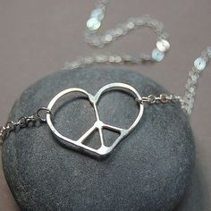 Tiny Heart Peace Sign Necklace Individually Made by Laurel Peters, $32   I fixed the link! :P