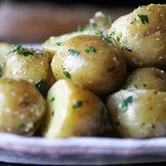 Boiled Potatoes Recipe Side Dishes with yukon gold potatoes, garlic, bay leaf, kosher salt, butter, chopped parsley, sea salt