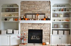 Beautiful shelving and fire place with cute fall decorations. I love autumn!