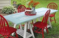 Check out this adorable outdoor picnic table from Embracing Change blogger Stacey Freet, which is made from little more than two old sawhorses and a thrifted door.     To add a pop of color, Freet gathered four mismatched chairs that she picked up from Freecycle and gave them all a coat of bright red paint for an eye-catching look that's sure to impress.