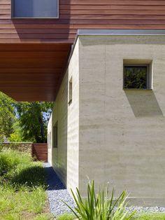 concrete w/creative sized windows cowper ccs rammed earth close up