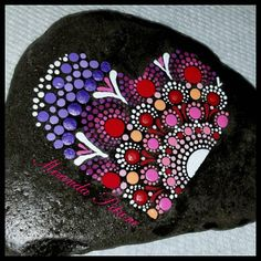 Hand painted stone Heart Size: 4x3 inch The stone is hand painted in acrylics and then varnished with a UV protectant varnish