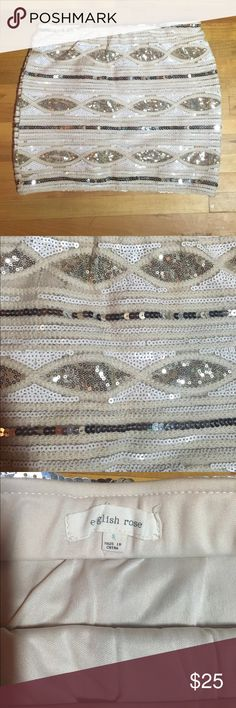English Rose Sequin Mini Skirt Size S NWOT English Rose Sequin mini Skirt Size S.With stretchy waistband.Came from a smoke and pet free home. English Rose Skirts Mini