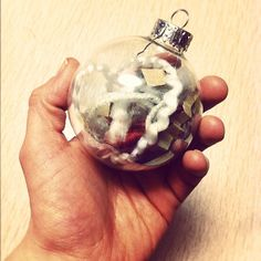 put a bunch of wrapping scraps in a clear bulb and get instant crafty ornaments!